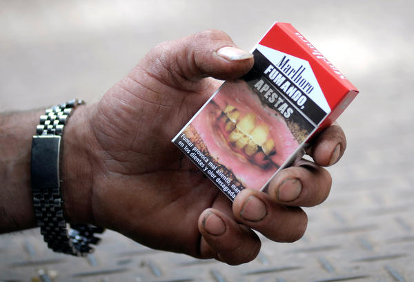 """Smoking, you stink,"" reads a cigarette package in Spanish that was used in an anti-smoking campaign in Uruguay."