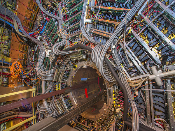 The STAR detector used in the antimatter experiment is the size of a house. It's able to track particles created when atoms collide at its center.