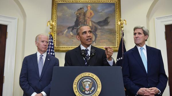President Obama, flanked by Secretary of State John Kerry (right) and Vice President Joe Biden, announced the Keystone XL pipeline decision Friday in the Roosevelt Room of the White House.
