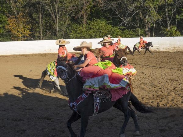 The Amazonas perform in the rodeo ring their family built in Catlett, Va.