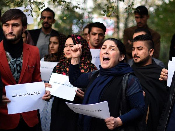 Activists protest in Kabul against Taliban militants who stoned an Afghan woman to death after accusing her of adultery.