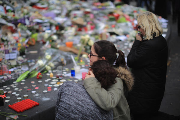 People weep as they gather Monday at the Place de la Republique to observe a minute of silence in memory of the victims of the Paris terror attacks.