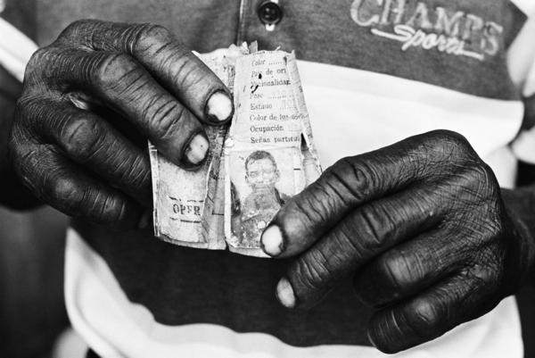 These hands belong to a 67-year-old man who's lived in the Dominican Republic for over 50 years — one of the thousands of people of Haitian descent who are stateless. Constantine learned that a company ID card, issued decades ago, is the man's only piece of identification.