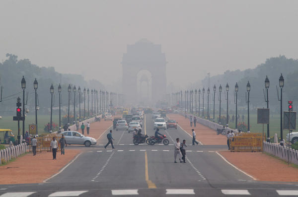 India Gate, a central Delhi landmark, is barely visible through thick smog in early November. The city's air quality has hit new lows recently.