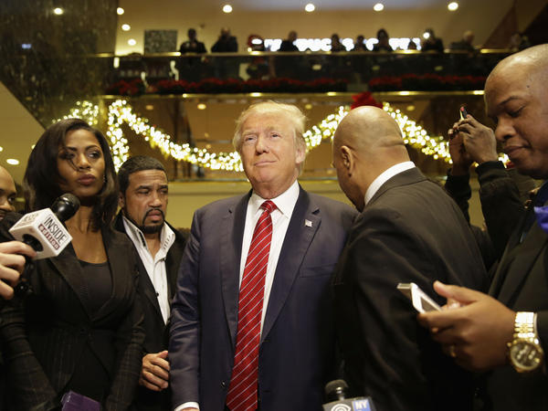 Republican presidential candidate Donald Trump joins a group of African-American religious leaders to speak to reporters in New York on Monday. Trump met with a coalition of African-American evangelical pastors and religious leaders in a private meeting at Trump Tower.