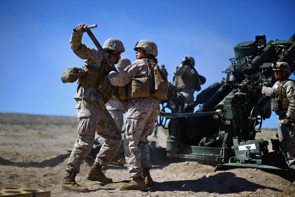 Defense Secretary Ash Carter is expected to announce that women can now serve in front-line combat posts. Here, Carolina Ortiz moves away from a 155-mm artillery piece after loading it during a live-fire exercise at the Marine base in Twentynine Palms, Calif., earlier this year, during a months-long study of how women might perform in ground combat jobs.