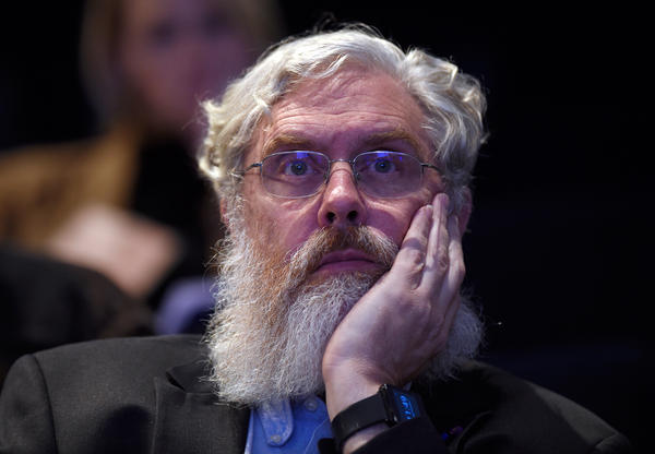 Harvard Medical School's George Church listens to a discussion about the safety and ethics of human gene editing at a summit meeting Tuesday.