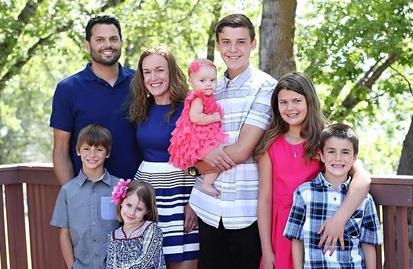 Michael Raymond Wetzel (left, back row), seen with his family in this undated photo, died in the San Bernardino attack.