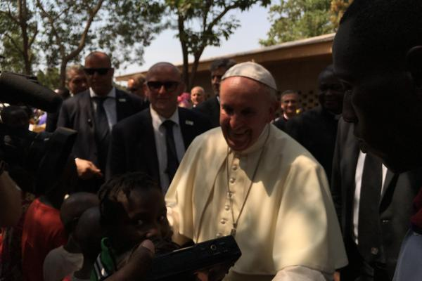 Pope Francis greets people at the Saint Sauveur displaced persons camp in Bangui, Central African Republic.