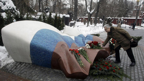 Yuri Baturin, a former aide to Boris Yeltsin, lays flowers at the Russian president's grave at the Novodevichy Cemetery in Moscow.