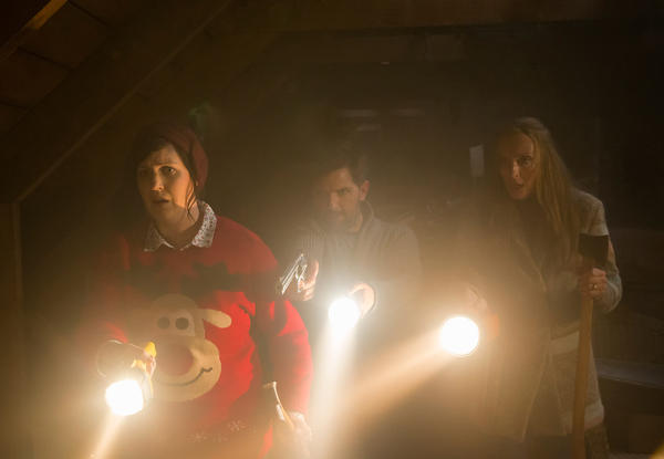 In <em>Krampus</em> a family is stalked by a horrible figure taken from German and Austrian mythology. Above, Allison Tolman from left, Adam Scott Toni Collette.