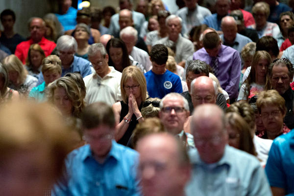 Attendees pray during the Family Leadership Summit — an event sponsored by the conservative Family Leader organization — in Ames, Iowa, in July.