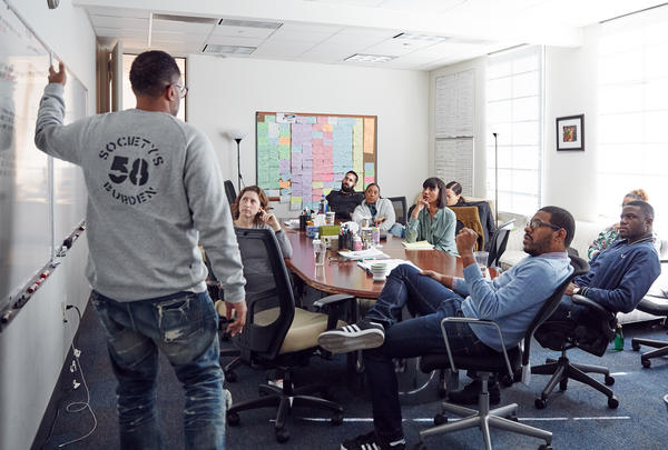 Kenya Barris plots out the storyline of upcoming episodes with the other show writers in the writer's room on the ABC lot in Burbank, Calif.