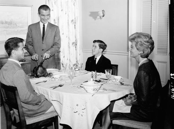 A scene from the TV show <em>Leave It to Beaver.</em> The 1950s emphasized the importance of a happy nuclear family — and in popular media, the dining table often became a place to showcase these idealized dynamics.