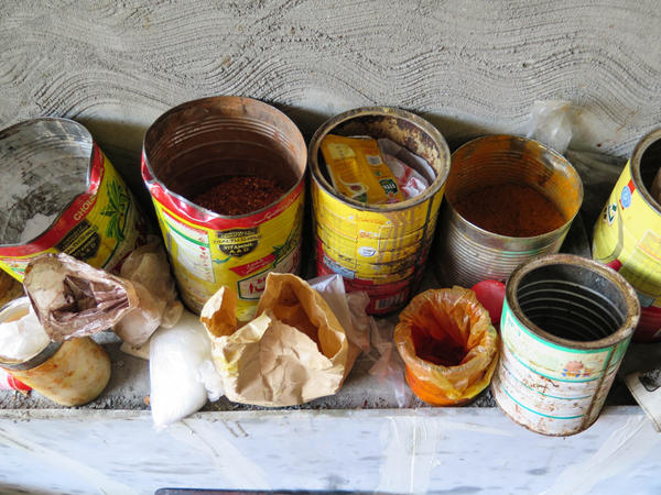 Tin cans and grubby little bags found during Ayesha Mumtaz's raid of a backstreet sweets factory in Lahore, Pakistan.