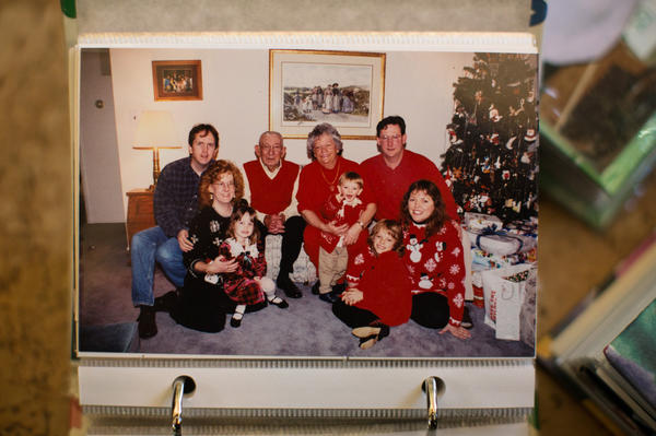 Helen and her late husband, Raymond, pose with the family in 1997. Christmas was a big event then, with matching outfits, stacks of presents and lots of food.