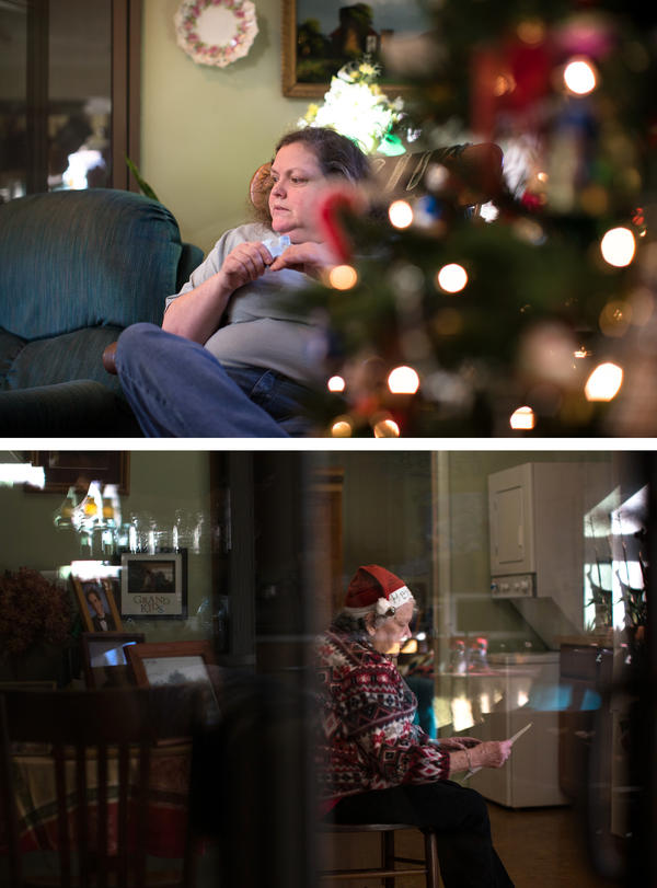"""""""For me the hard part is that my mother-in-law is still with us physically, but mentally she's not there,"""" Mary says. """"It's almost like having somebody that's a stranger at Christmas."""" Helen sorts through family photos. She often talks about life on the farm in Virginia where she grew up."""