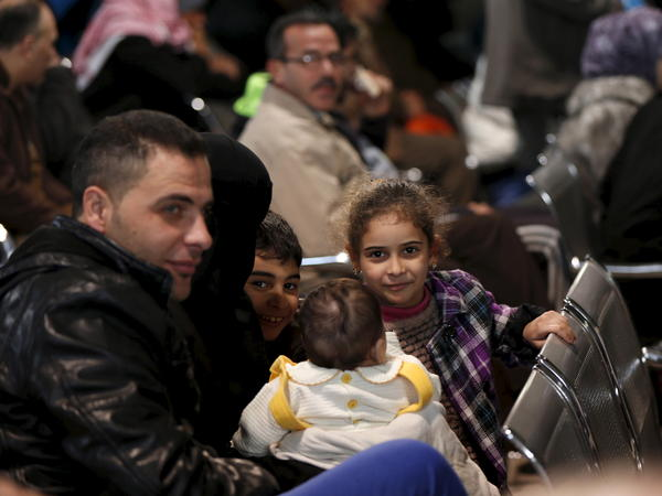 Syrian refugees wait to register at the United Nations High Commissioner for Refugees office in Amman, Jordan, last week. More than 1,000 Syrian refugees in Jordan were interviewed by the UNHCR on Friday alone for a chance to go to Canada.