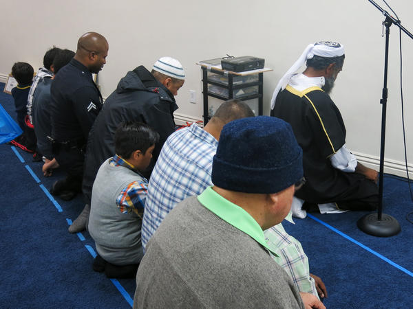 Alexander (at left), a practicing Muslim, prays during a visit to a Los Angeles-area madrassa, part of his unit's outreach to the Muslim community.