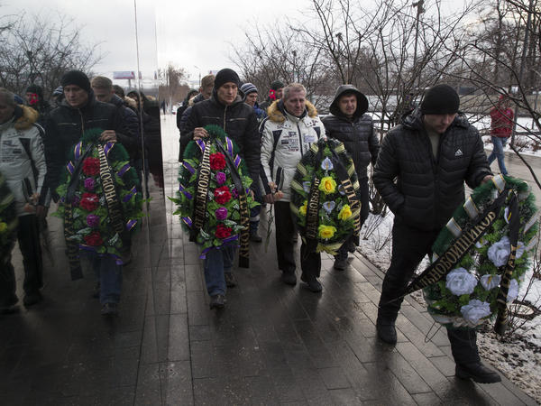 Truck drivers and their supporters walk with symbolic wreaths, which they plan to lay near an office of a new road payment system, outside Moscow on Dec. 13. Truck drivers have been protesting the new road toll for weeks.