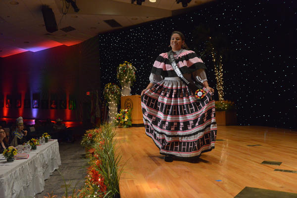 Skyla Osceola, 16, wears a striking hand-made cotton traditional patchwork dress with Man on Horse and H symbols, which she made with the help of her mother, Francine Osceola. Skyla won the Jr. Miss Florida Seminole Princess crown.