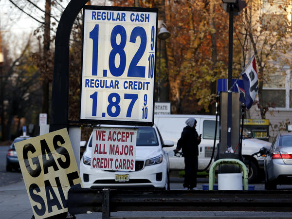 Gas prices are displayed at a service station in Leonia, N.J., Nov. 24. Gas is under $2 a gallon across much of the country and the price is expected to remain low next year.