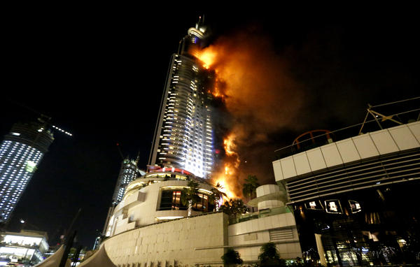 A fire engulfs the Address Downtown Dubai, a luxury hotel in Dubai in the United Arab Emirates on Thursday.