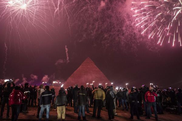 Egyptians celebrate the new year in front of the pyramids near the Egyptian capital Cairo.