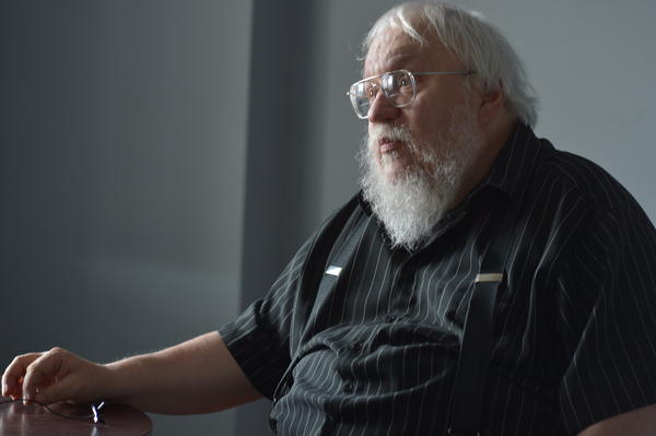 George R.R. Martin answers questions before a game between the Hudson Valley Renegades and the Staten Island Yankees — briefly renamed the Staten Island Direwolves for their <em>Game of Throne</em> night in August. Now, four months later, Martin has some bad news for his fans.