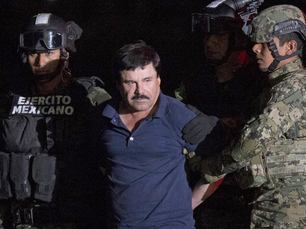 "Drug kingpin Joaquin ""El Chapo"" Guzman, escorted by army soldiers to a waiting helicopter, at a federal hangar in Mexico City on Friday."