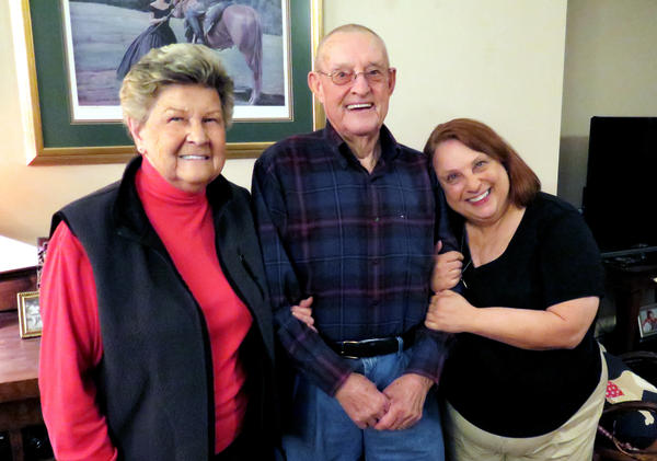 Mary Harris (from left) and her husband, Dan, along with their daughter Zeean Bumpus. Dan, his father, his grandfather, his former son-in-law and his grandson have all been coal miners.