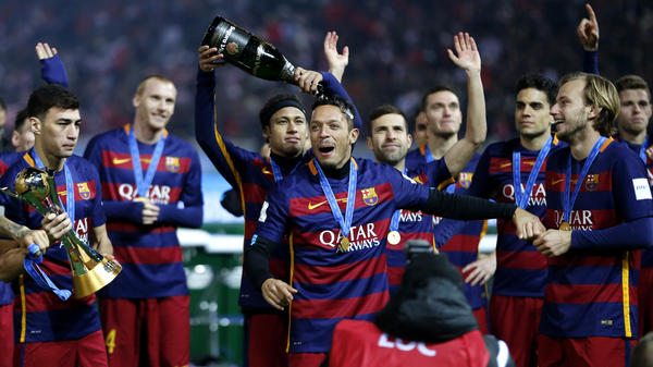 Futbol Club Barcelona's Neymar da Silva Santos pours champagne over Adriano as their team won the final match against River Plate at the FIFA Club World Cup soccer tournament in Yokohama, near Tokyo, on Dec. 20.