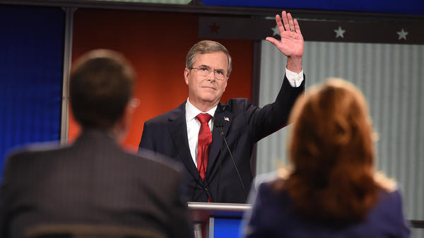 Republican presidential candidate and former Florida Gov. Jeb Bush waves to the audience during the Fox Business Network Republican presidential debate Thursday.