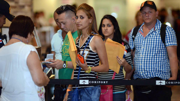 Cuban migrants prepare to board a flight from Costa Rice to El Salvador on Jan. 12. This was the first of up to 28 flights out of Costa Rica that will allow nearly 8,000 stranded Cubans to continue their journey to the United States.
