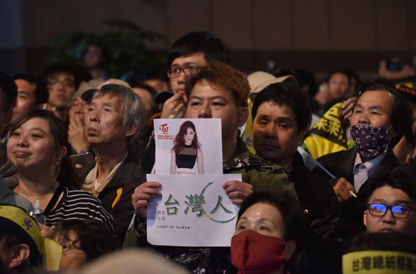 Before Taiwan's Democratic Progressive Party sealed the vote in the nation's presidential elections on Saturday night, K-pop singer Chou Tzu-yu was forced to apologize after waving the Taiwanese flag on a TV broadcast. A DPP supporter holds a sign showing Tzu-yu.