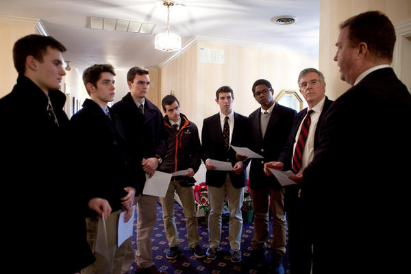 Roxbury Latin seniors Chris Rota, Liam McDonough, Emmett Dalton, Esteban Enrique, Brendan McInerney and Noah Piou, and assistant headmaster Mike Pojman, listen as funeral director Bob Lawler explains the circumstances of the death of Nicholas Mlller, whose body was unclaimed, at the Robert J. Lawler & Crosby Funeral Home.