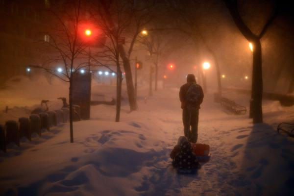 Children are pulled home after playing in the snow in New York City, on Jan. 23.