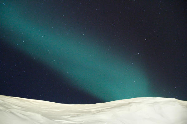 The Northern Lights over the town of Ittoqqortoormiit, Greenland — about 400 miles north of the Arctic Circle.
