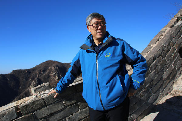 Dong Yaohui, vice chairman of the China Great Wall Society, walks on a relatively intact section of the wall near its eastern end. Dong was among three men who, in the 1980s, were the first Chinese known to have walked the wall's entire length from east to west.