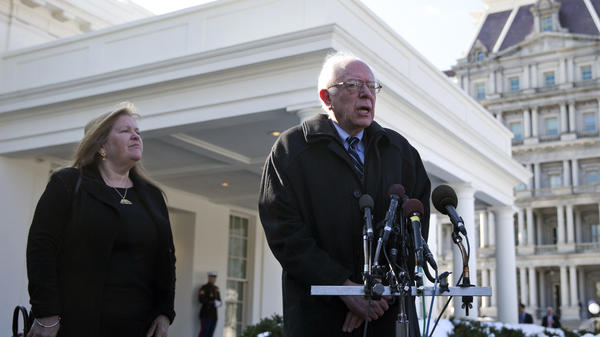 Democratic presidential candidate Bernie Sanders, joined by his wife, Jane Sanders, speaks to the media outside the White House following his meeting with President Obama on Wednesday.