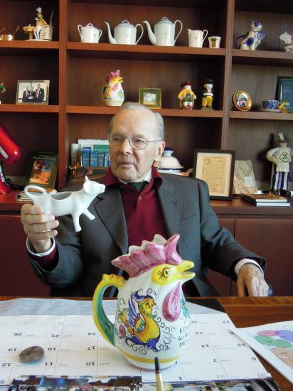 Chuck Williams in 2011 in his San Francisco office with a painted water pitcher in the form of a chicken and other items from his collection.