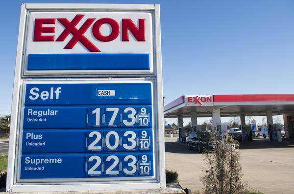 Consumers have been benefiting from lower gas prices. Here, prices dip below $2 per gallon at an Exxon station in Woodbridge, Va., on Jan. 5.