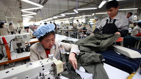 North Korean employees work at the assembly line of a South Korean company at the Kaesong Industrial Complex. South Korea announced Wednesday it is shutting down the industrial park, following North Korea's recent nuclear test and rocket launch.