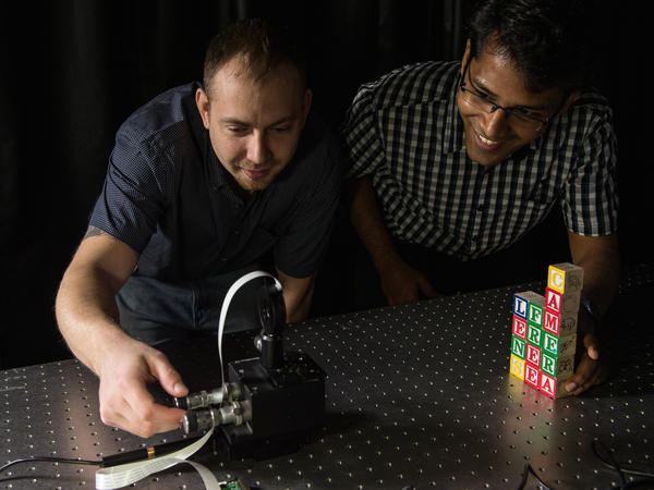 Rice University graduate students Jesse Adams and Vivek Boominathan set up a test shot with a FlatCam prototype.