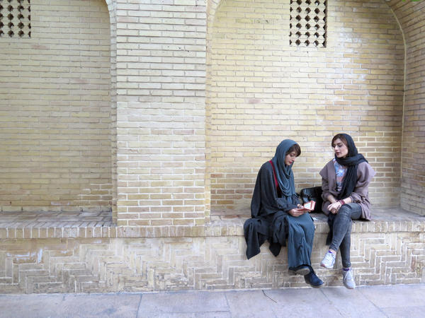 Shaghayagheh Aghazadeh, left, and Atikeh Karimi enjoy some quiet moments at the tomb of Hafez, where they seek clues to the future through the poet's words.