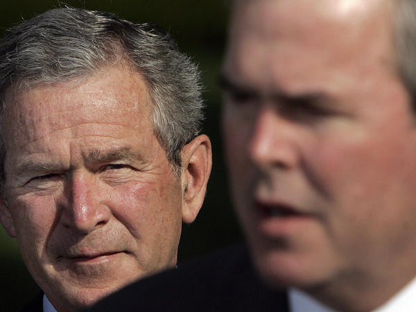 Former President George W. Bush, seen here in 2006 with his brother Jeb Bush in the foreground, has largely shied away from political activity since he left office.