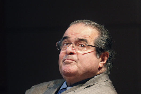 In this Oct. 18, 2011, file photo, U.S. Supreme Court Justice Antonin Scalia looks into the balcony before addressing the Chicago-Kent College of Law justice.