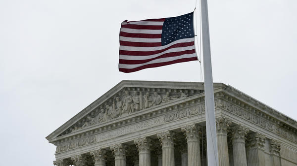 The flag flies at half-staff outside the Supreme Court in Washington, D.C., on Tuesday, following the death of high court Justice Antonin Scalia.