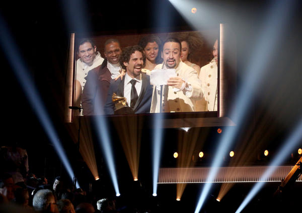 """Lin-Manuel Miranda, right, appears on screen accepting the award for best musical theater album for """"Hamilton"""" at the 58th annual Grammy Awards on Monday, Feb. 15, 2016, in Los Angeles. (Matt Sayles/Invision/AP)"""