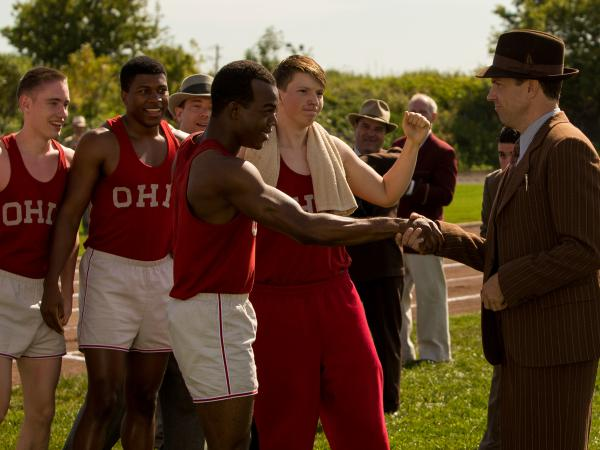 Stephan James (center) stars as Jesse Owens and Jason Sudeikis (right) stars as Larry Snyder in Stephen Hopkins' <em>Race</em>.